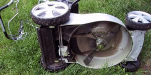 gas lawn mower blade override